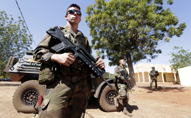 French soldiers stand guard at the Mali air force base near Bamako