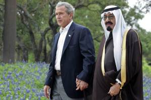 - FILE PHOTO TAKEN 25APR05 - U.S. President George W. Bush walks with Saudi Arabia's Crown Prince Abdullah (R) on his ranch in Crawford, Texasm in this April 25, 2005 file photo. [Saudi Arabia's Kind Fahd died on August 1, 2005 and Crown Prince Abdullah was swiftly pronounced monarch of the world's largest oil exporter and key U.S. ally.] - RTXNOCJ