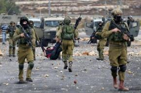 Israeli soldiers detain a wounded Palestinian protester during clashes near the Jewish settlement of Bet El